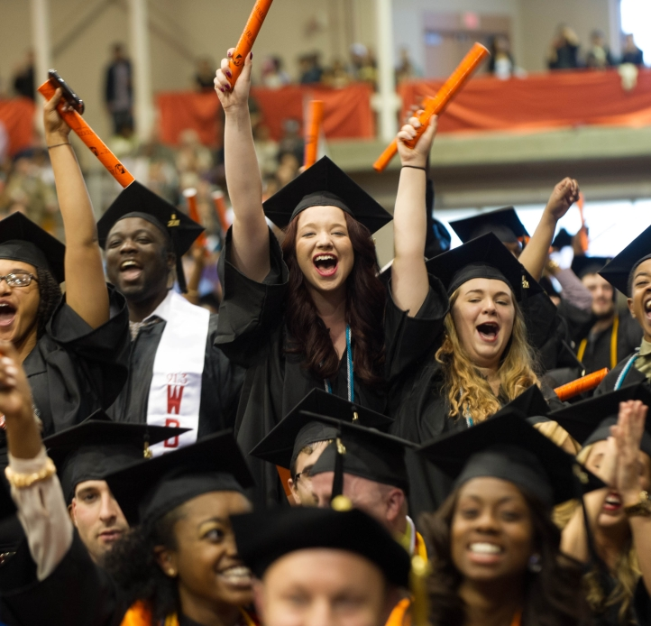 Students cheering at commencement
