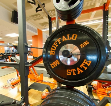 Weights and lifting bench in Buffalo State's Fitness Center
