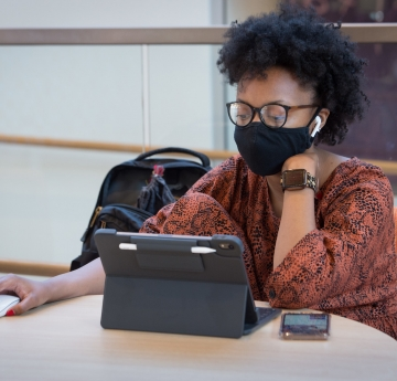 Student wearing mask using laptop