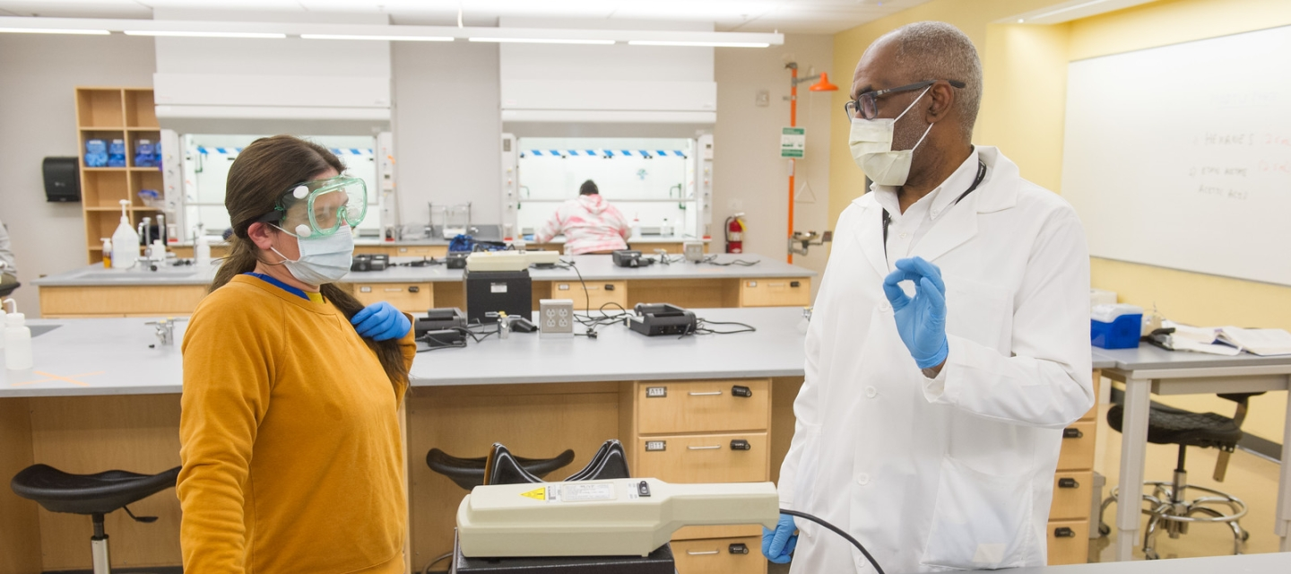 Student with professor in chemistry lab