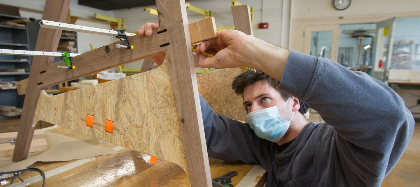 Student in wood design lab class